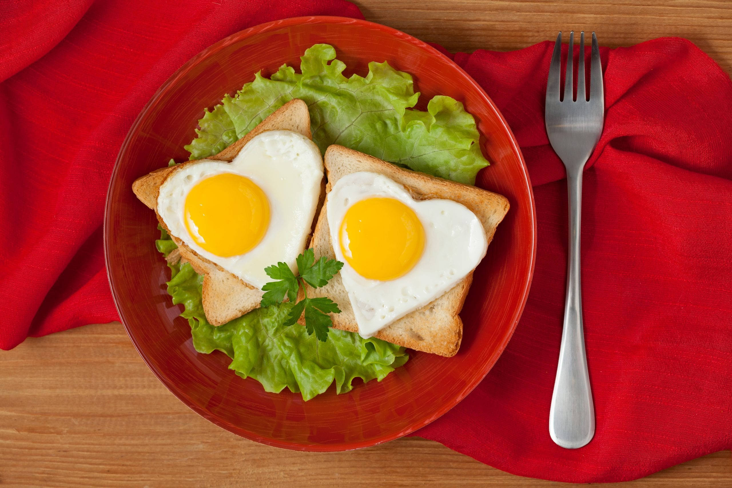Two heart shaped fried eggs
